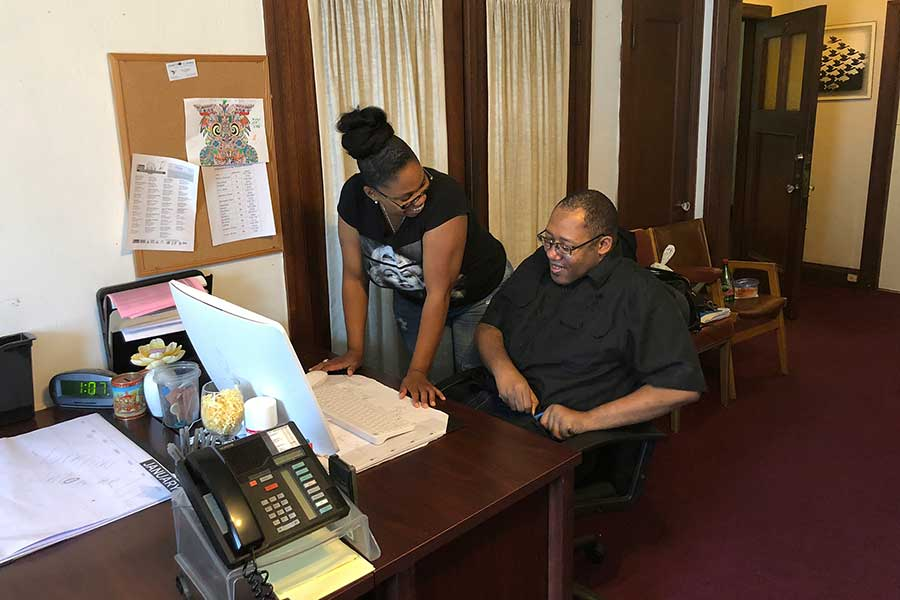 Job coach assists a Clausen House client with finding a new job.